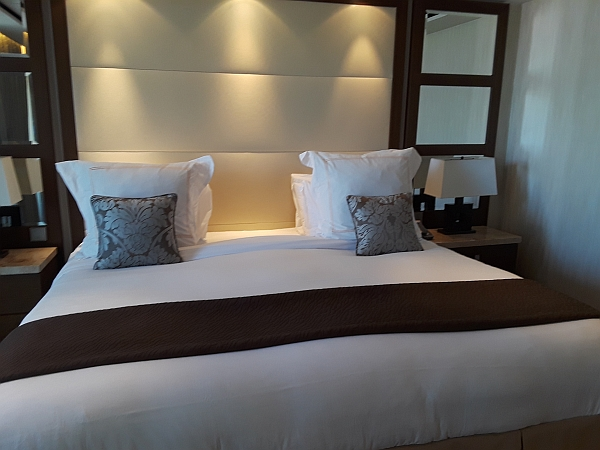 Photo of bed in suite on board Celebrity Eclipse